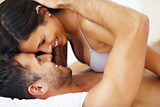 Couple touching noses in bed